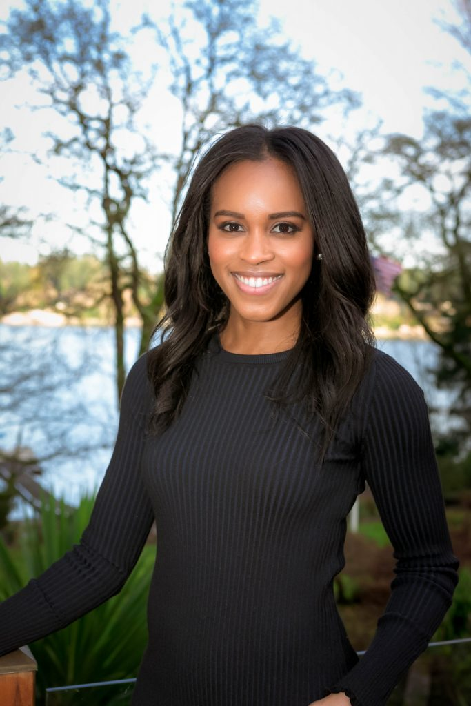 Black woman smiling for professional headshot outdoors